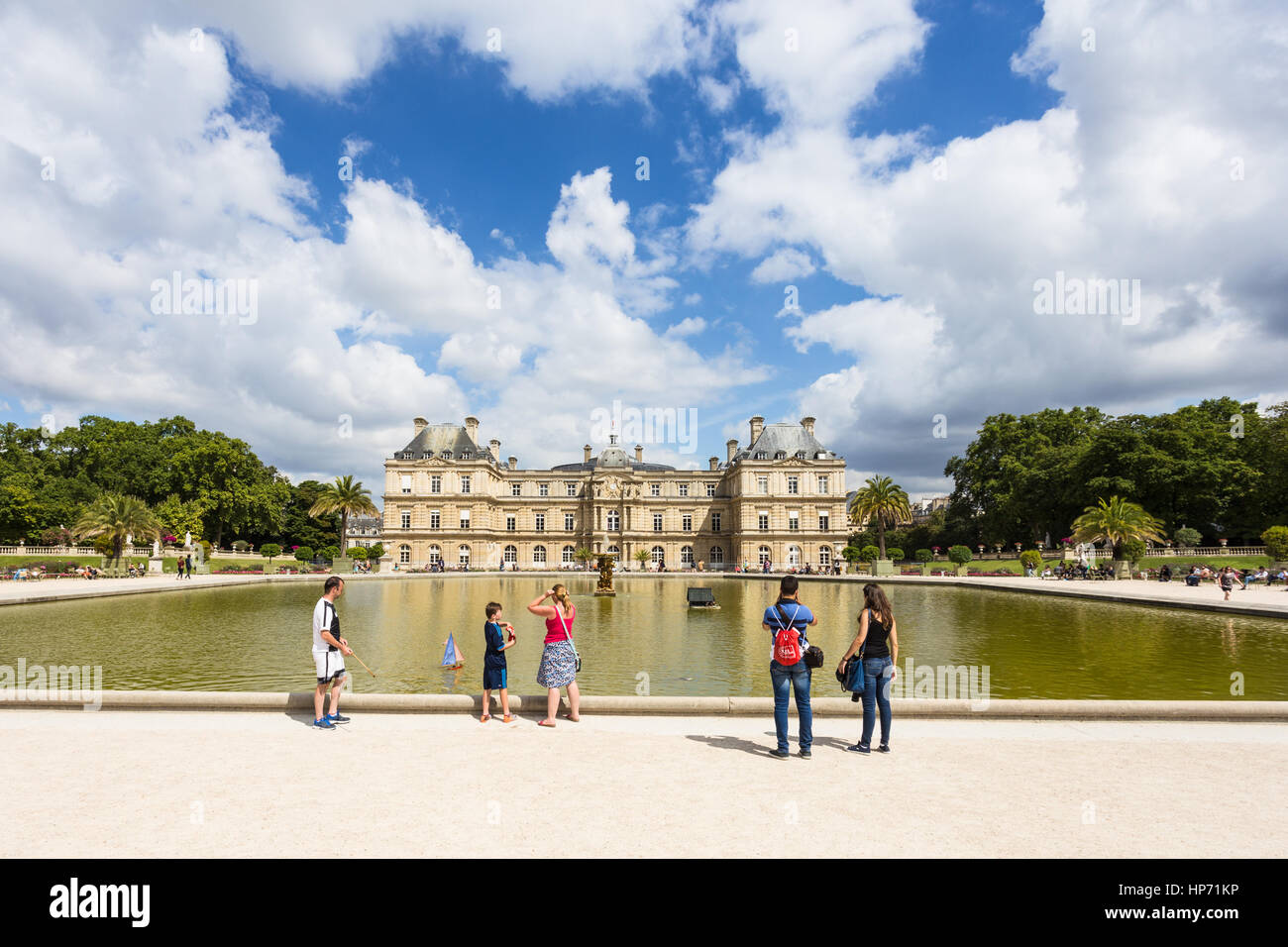 PARIS - AUGUST 6, 2016: Tourist enjoy view of the Luxembourg Palace in Paris, France capital city. - Stock Image