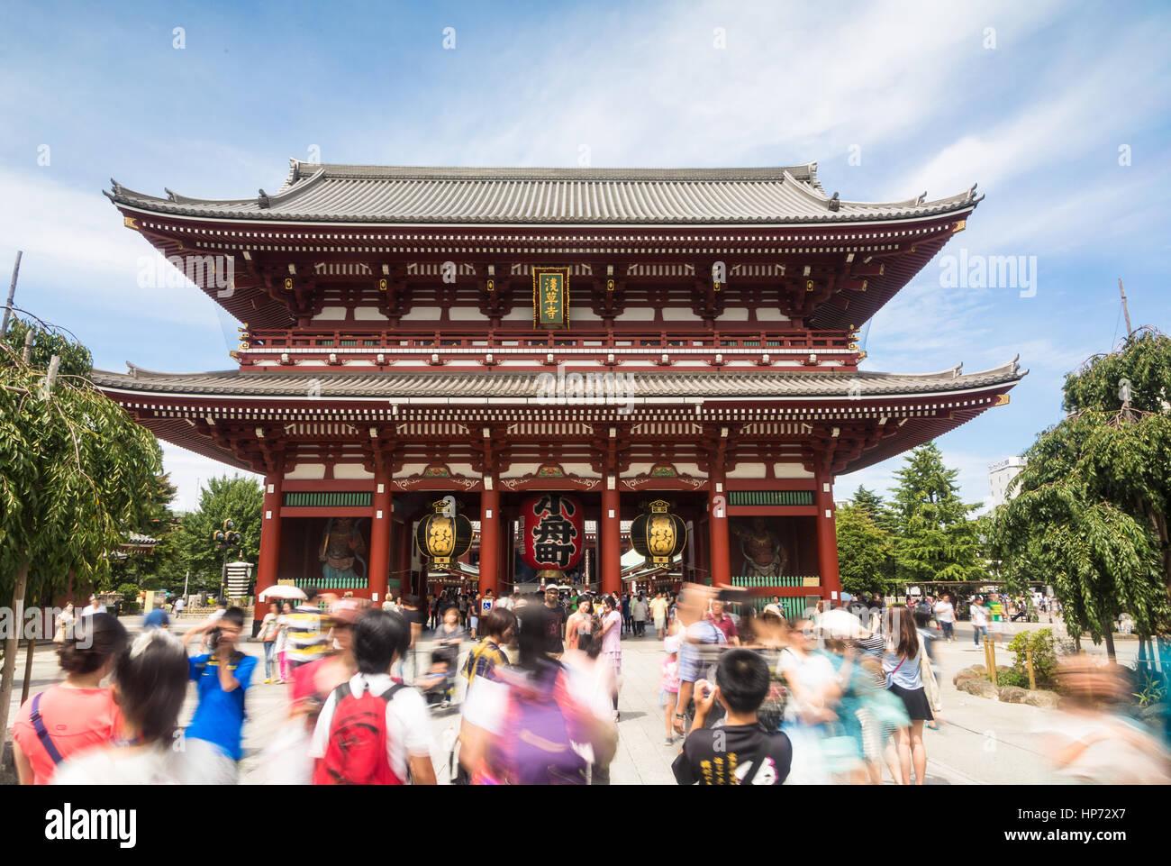 TOKYO, JAPAN - AUGUST 24, 2015: People, captured with blurred motion, visit the famous Senso-ji Buddhist temple Stock Photo