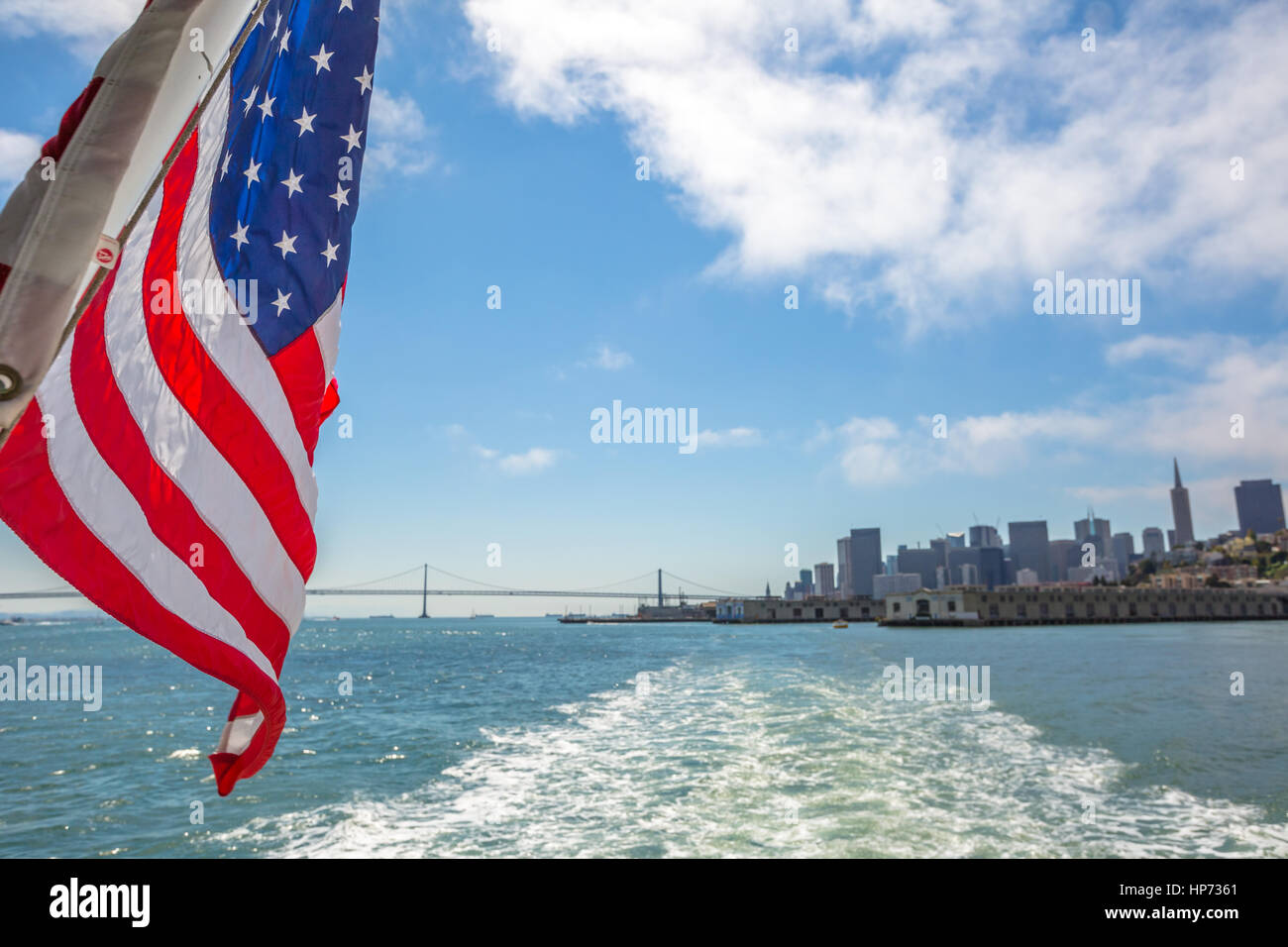 San Francisco Financial District skyline and Oakland Bridge on sunny day, California, United States. Sea views from - Stock Image