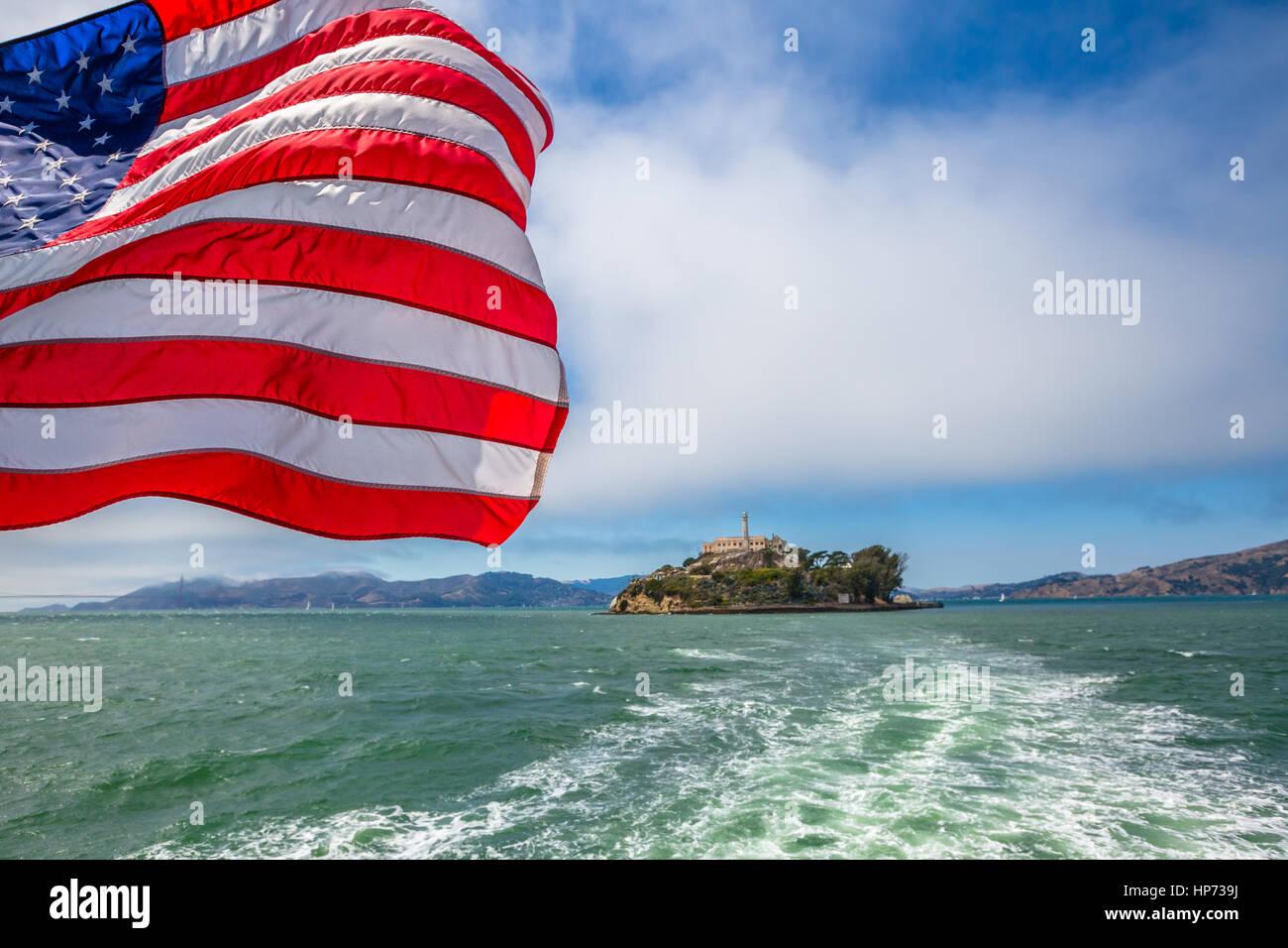 Alcatraz island in San Francisco Bay skyline, California, United States. Sea view from boat to Alcatraz with American Stock Photo