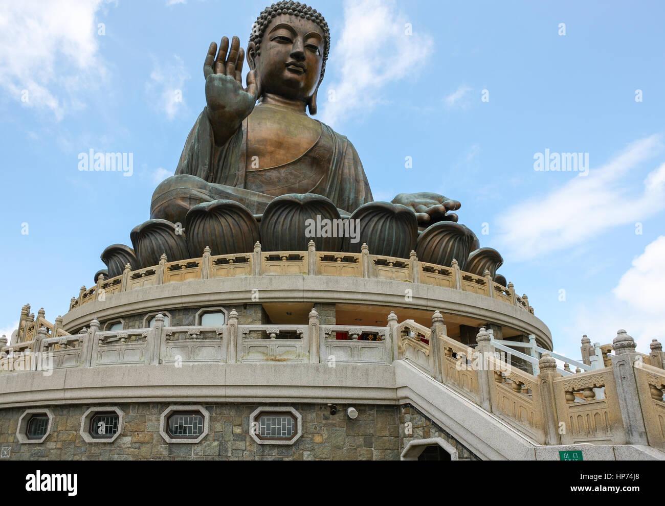 Giant Bronze Tian Tan Buddha on a hillside on Lantau Island - Stock Image