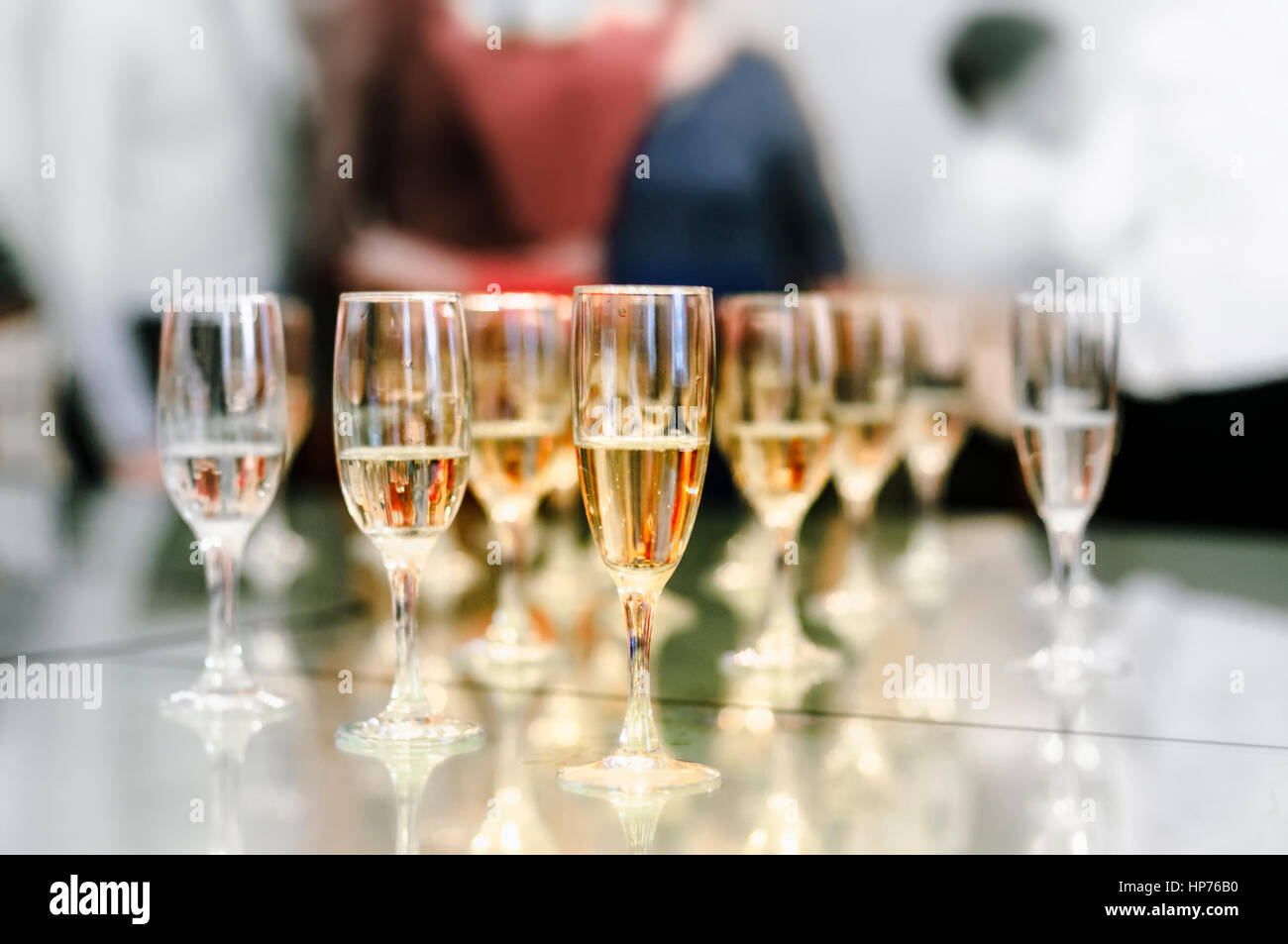 Glasses of champagne on the table - Stock Image