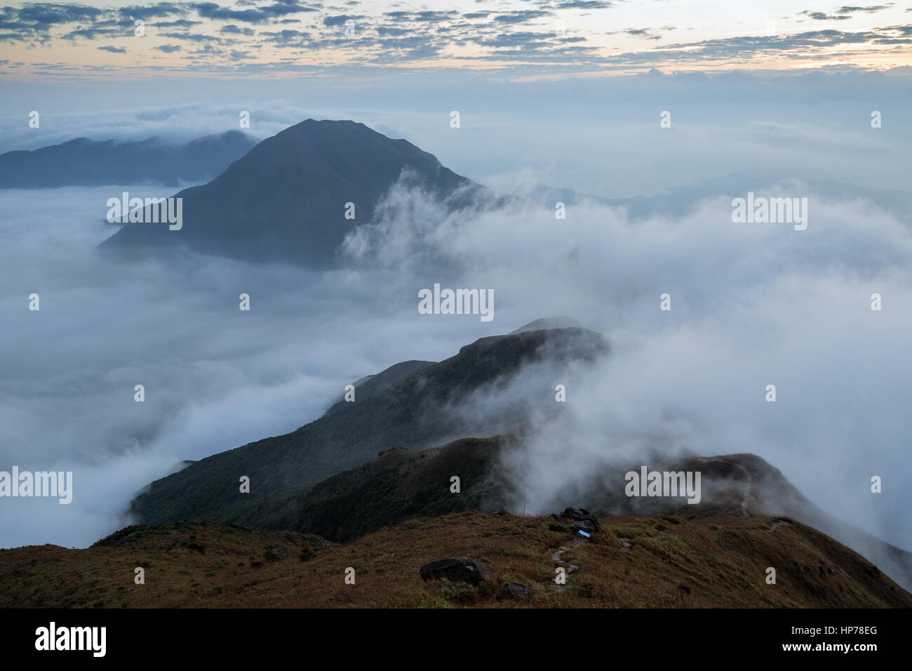 Cloudy view from the Lantau Peak (the second highest peak in Hong Kong, China (934m)) at dawn. - Stock Image