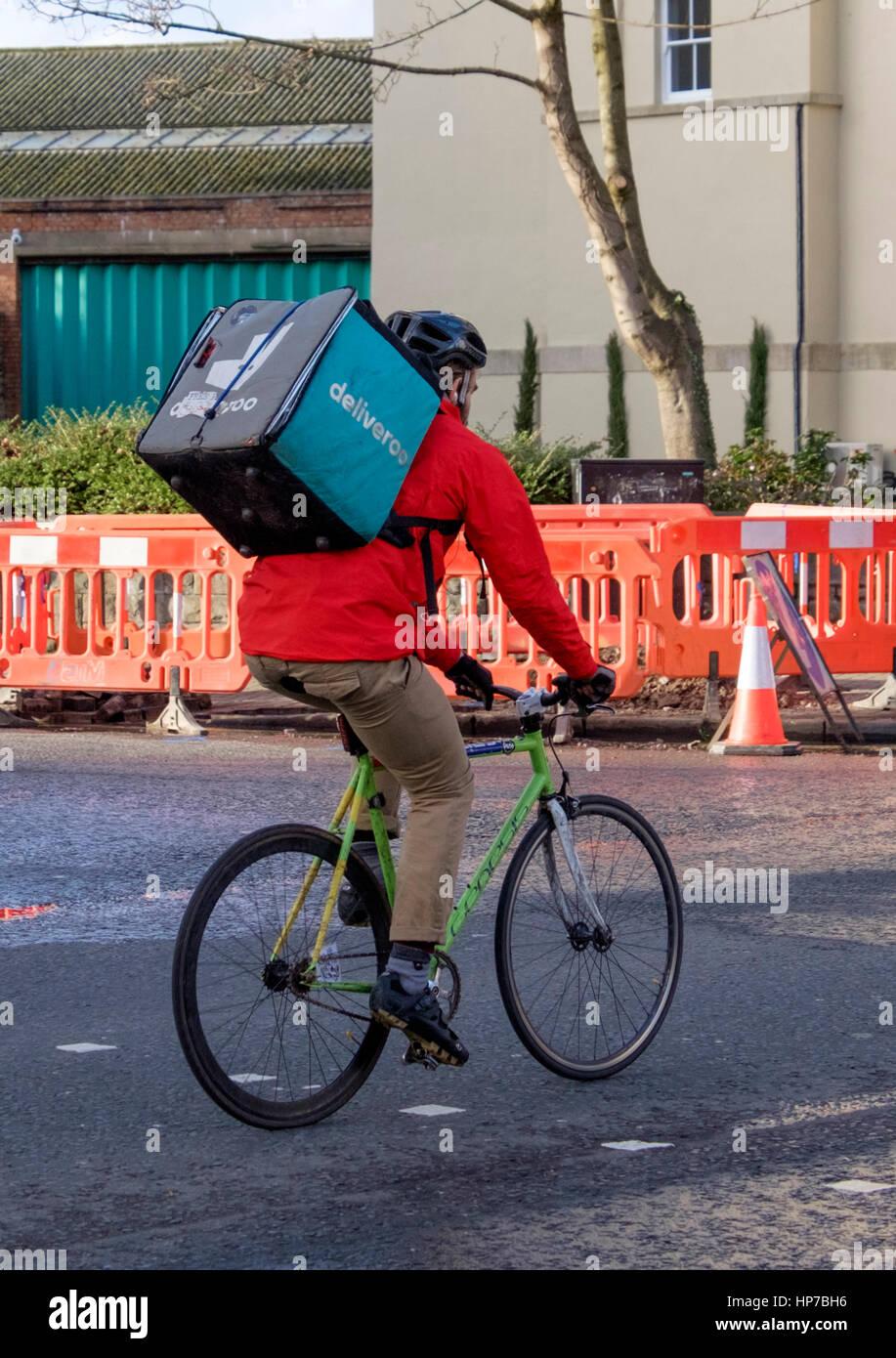 c7da97a8f43 A Deliveroo delivery man in a bike in Bristol Stock Photo: 134157778 ...