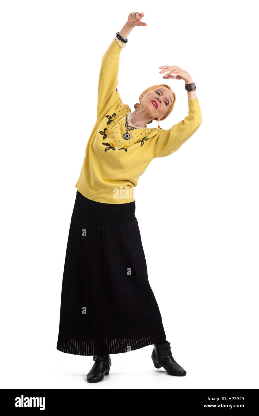 Old woman dancing. Senior lady isolated. Live by art. - Stock Image