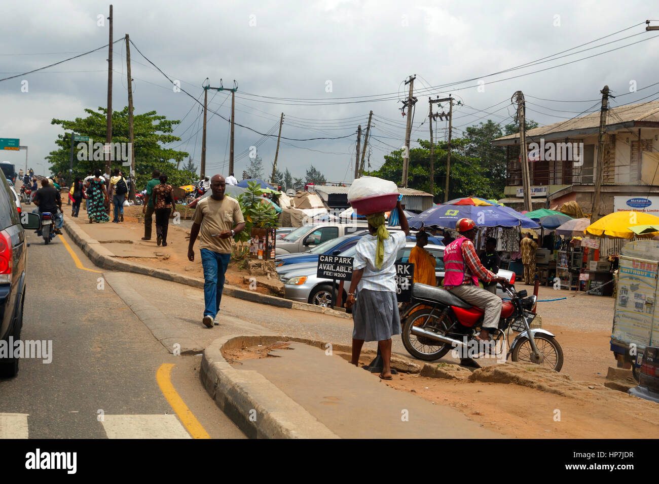 LAGOS, NIGERIA - MAY 11, 2012: People in the street in the city view of Lagos, the largest city in Nigeria and the - Stock Image