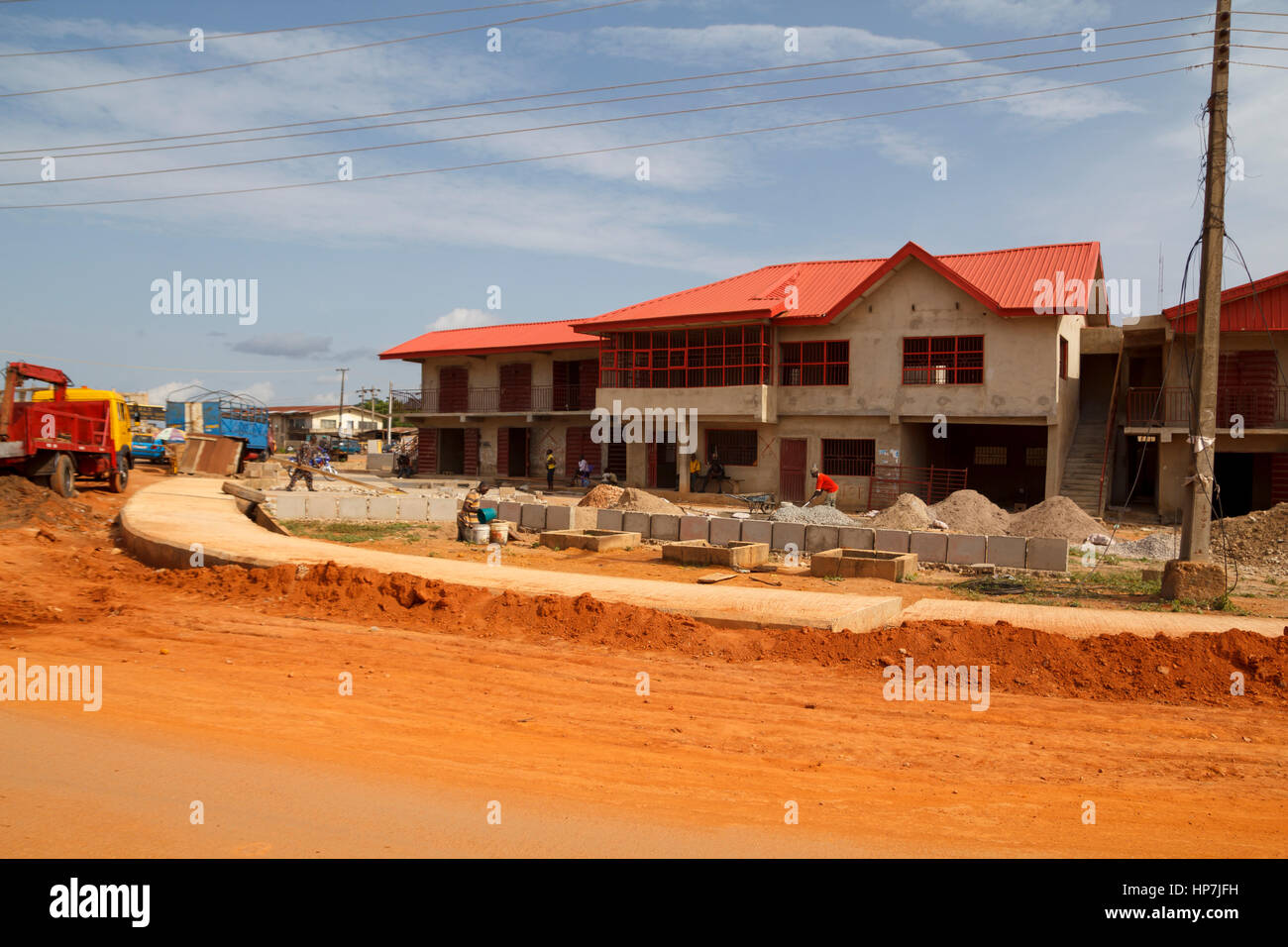 LAGOS, NIGERIA - MAY 11, 2012: Street under construction in a suburb of the nigierian city of Lagos, one of the - Stock Image