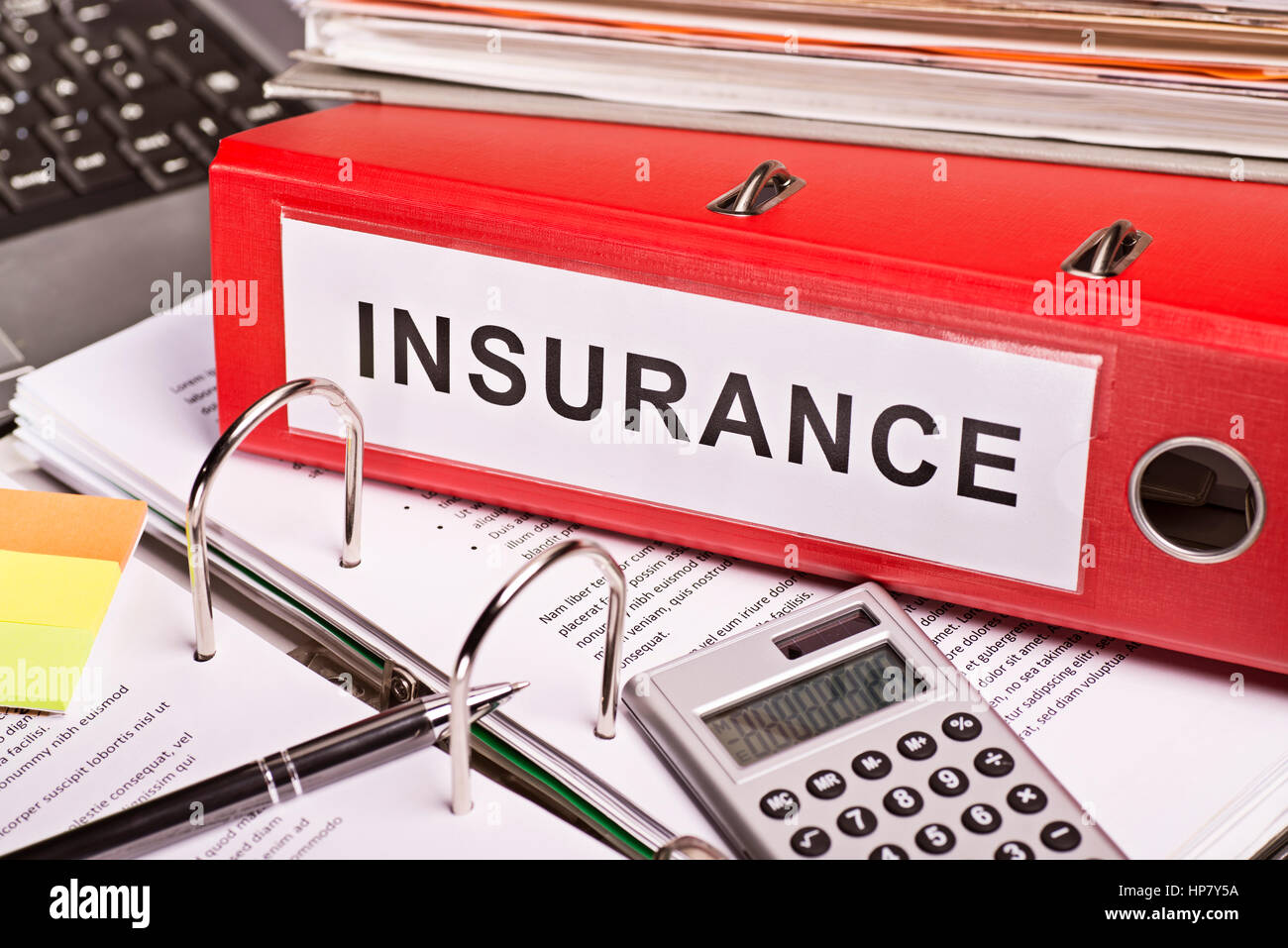 Red file folder with the label insurance. - Stock Image