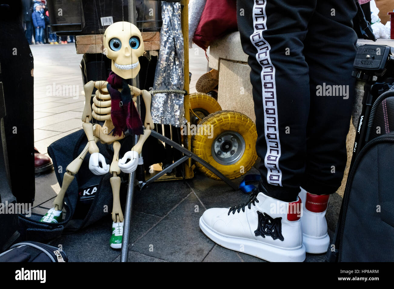Puppeteer prepares for street performance in Leicester Square, London - Stock Image