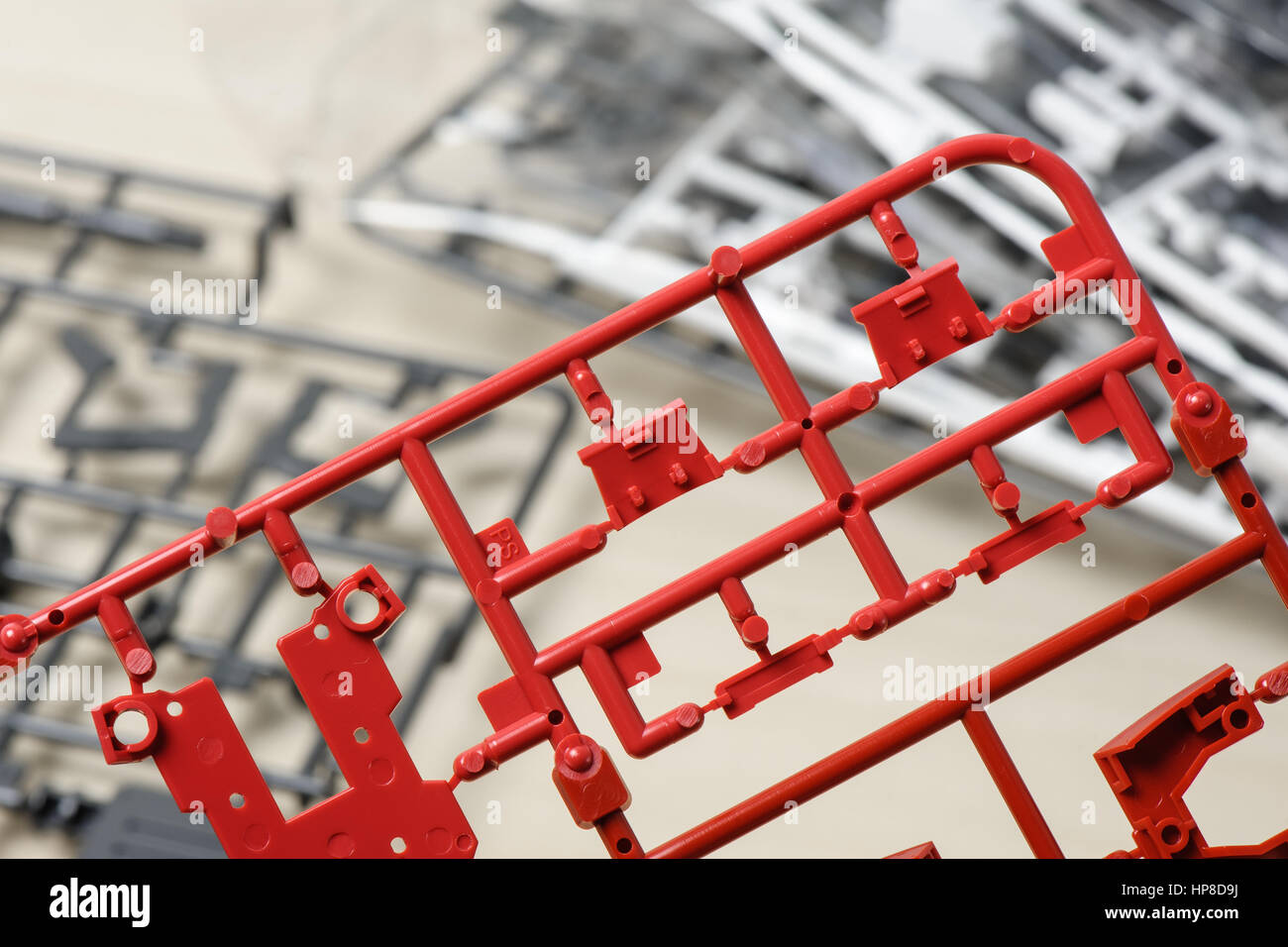 closeup sprue or injection molding of toy - Stock Image