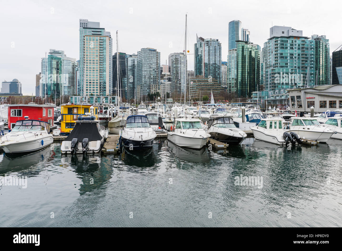 Vancouver, Canada - January 28, 2017: Vancouver city skyline with boats in foreground Stock Photo