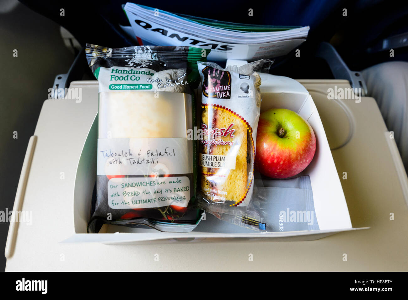Lunch box on passenger's table on board a QantasLink flight, New South Wales, Australia - Stock Image