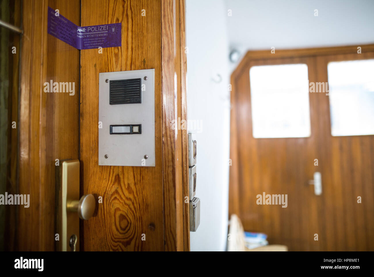 A police tape is attached to the door of a house in which the dead bodies of two children were found on 18 February 2017 in Enz-Aurich Germany ... & A police tape is attached to the door of a house in which the dead ...