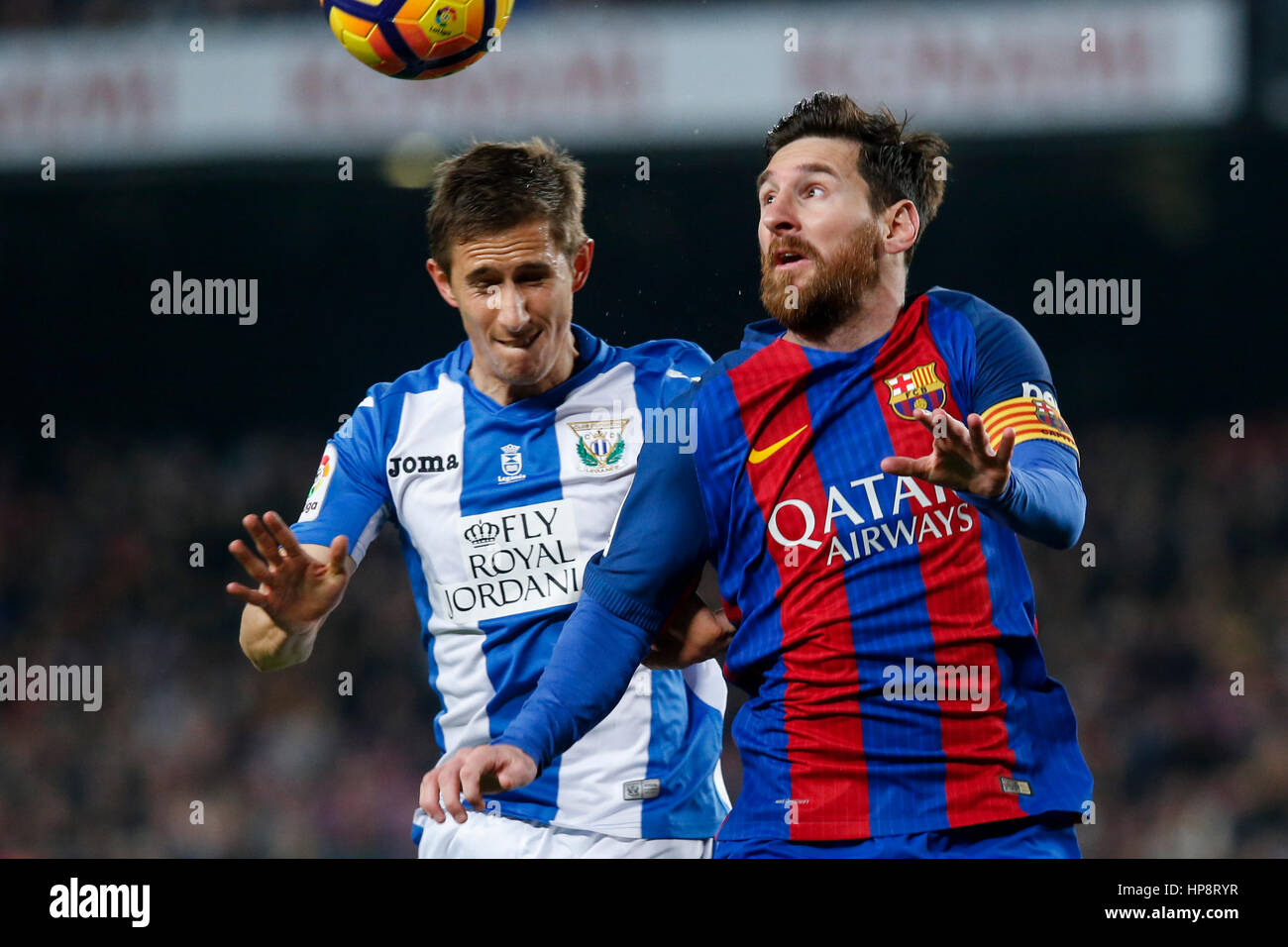 Barcelona, Spain. 19th Feb, 2017. Barcelona's Lionel Messi (R) vies with Leganes' Szymanowski during the - Stock Image