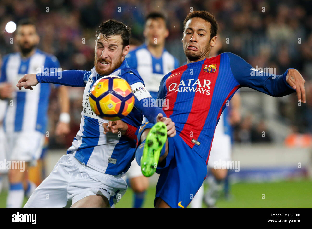 Barcelona, Spain. 19th Feb, 2017. Barcelona's Neymar (R) vies with Leganes' Tito during the Spanish first - Stock Image