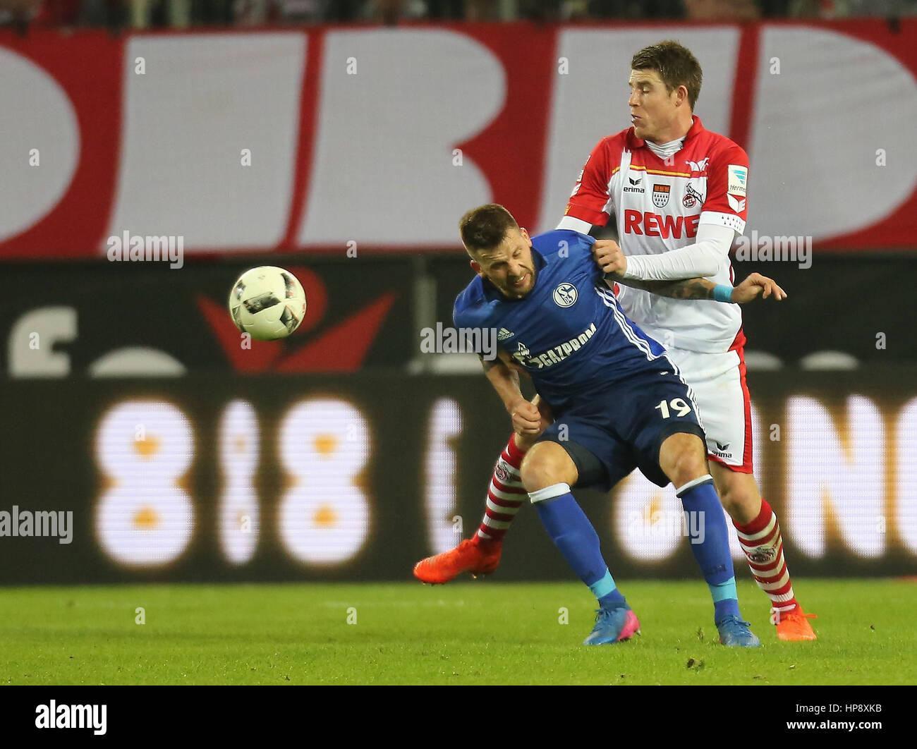 Cologne, Germany, February 19, 2017, Bundesliga matchday 21, 1. FC Koeln - FC Schalke 04:  Tackling  Dominique Heintz - Stock Image