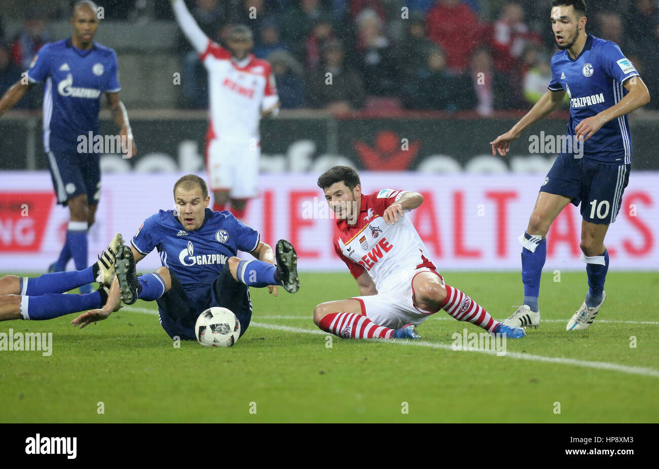 Cologne, Germany, February 19, 2017, Bundesliga matchday 21, 1. FC Koeln - FC Schalke 04:  Tackling Milos Jojic - Stock Image