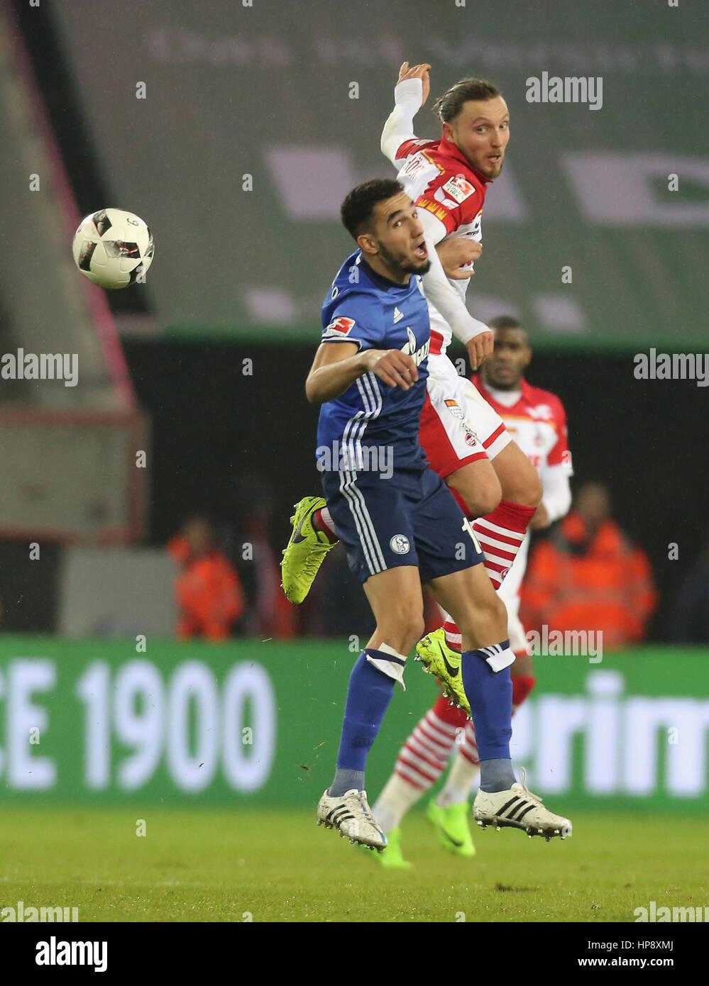 Cologne, Germany, February 19, 2017, Bundesliga matchday 21, 1. FC Koeln - FC Schalke 04:  Tackling Nabil Bentaleb - Stock Image