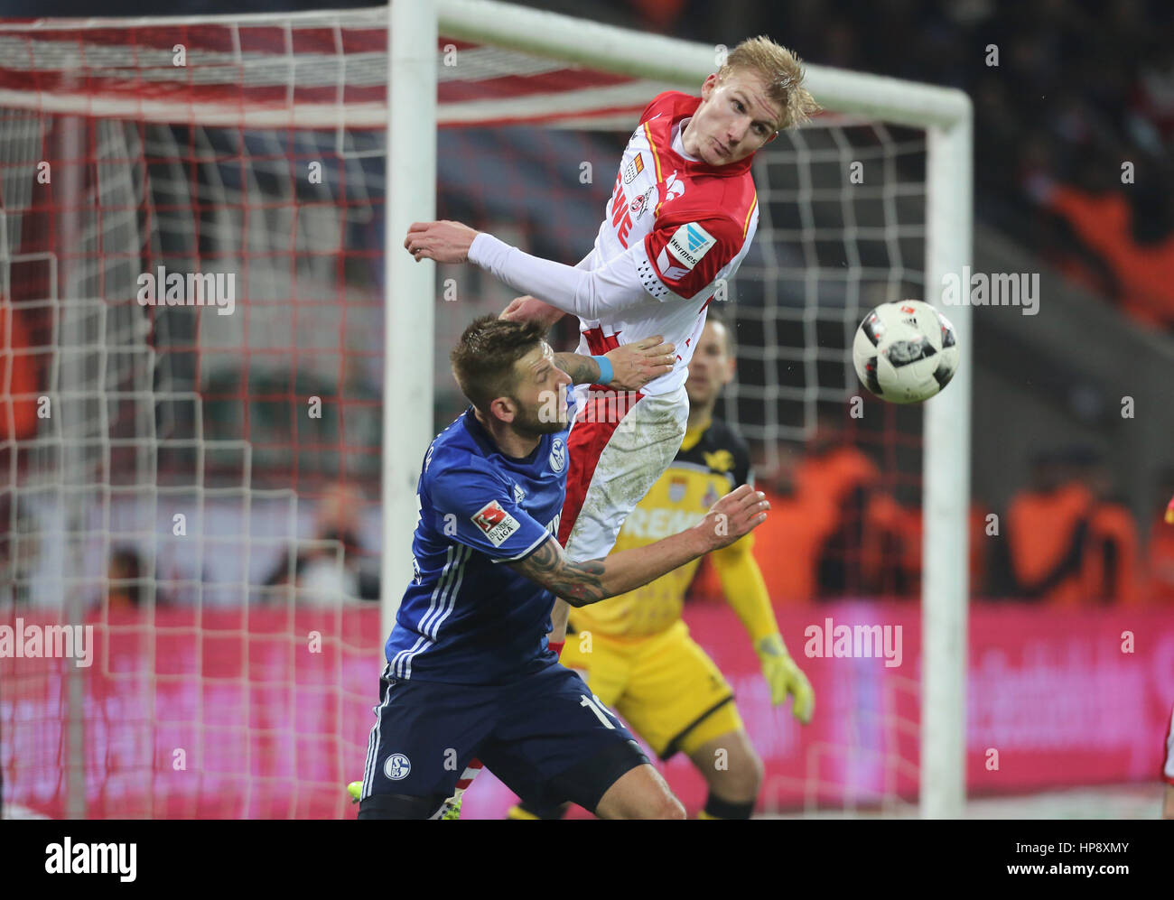 Cologne, Germany, February 19, 2017, Bundesliga matchday 21, 1. FC Koeln - FC Schalke 04:  Tackling Guido Burgstaller - Stock Image