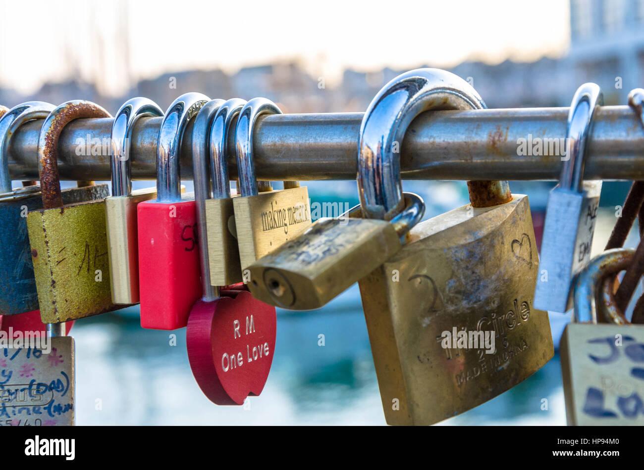 Love locks left on Pero's Bridge which spans Bristol Harbour. Romantic tourists leave padlocks on the bridge - Stock Image