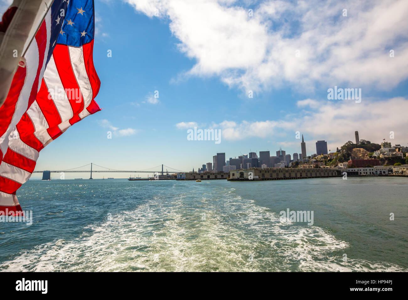 San Francisco Financial District cityscape and Oakland Bridge on sunny day, California, United States. Sea views - Stock Image