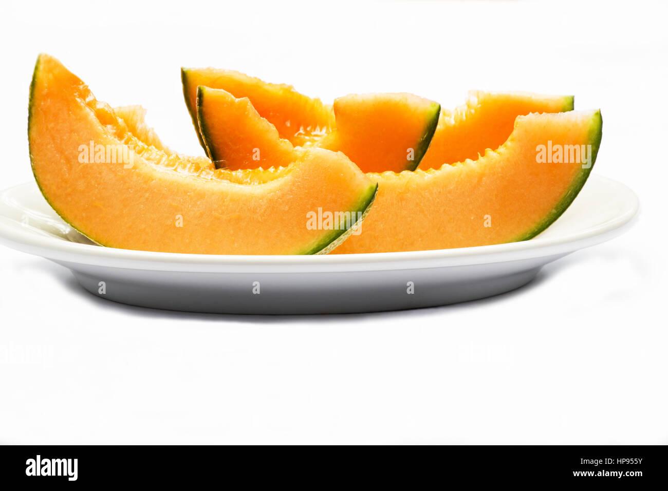 Melon slices on white background - Stock Image