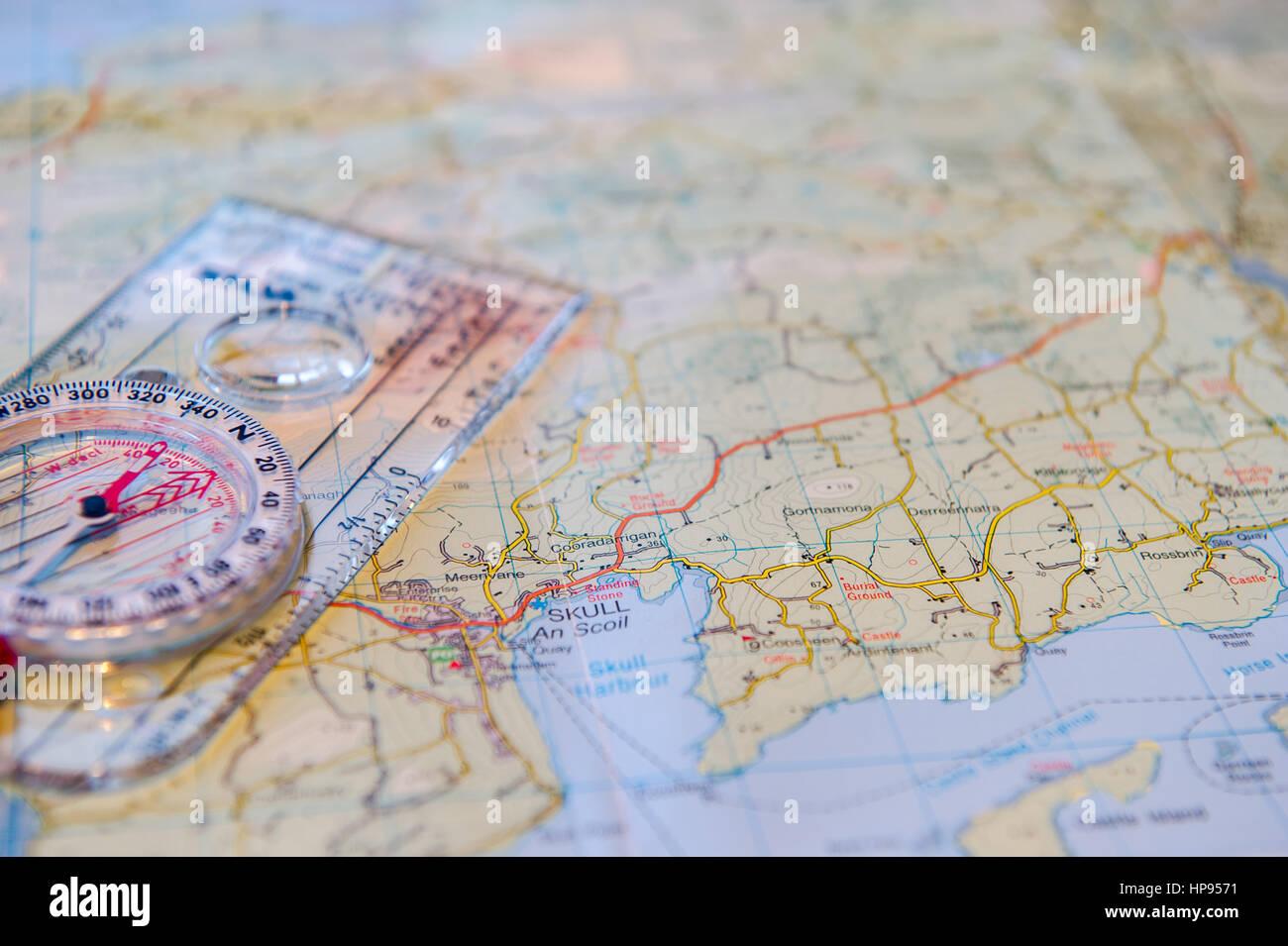 Silva compass lies on a map of Ireland. - Stock Image
