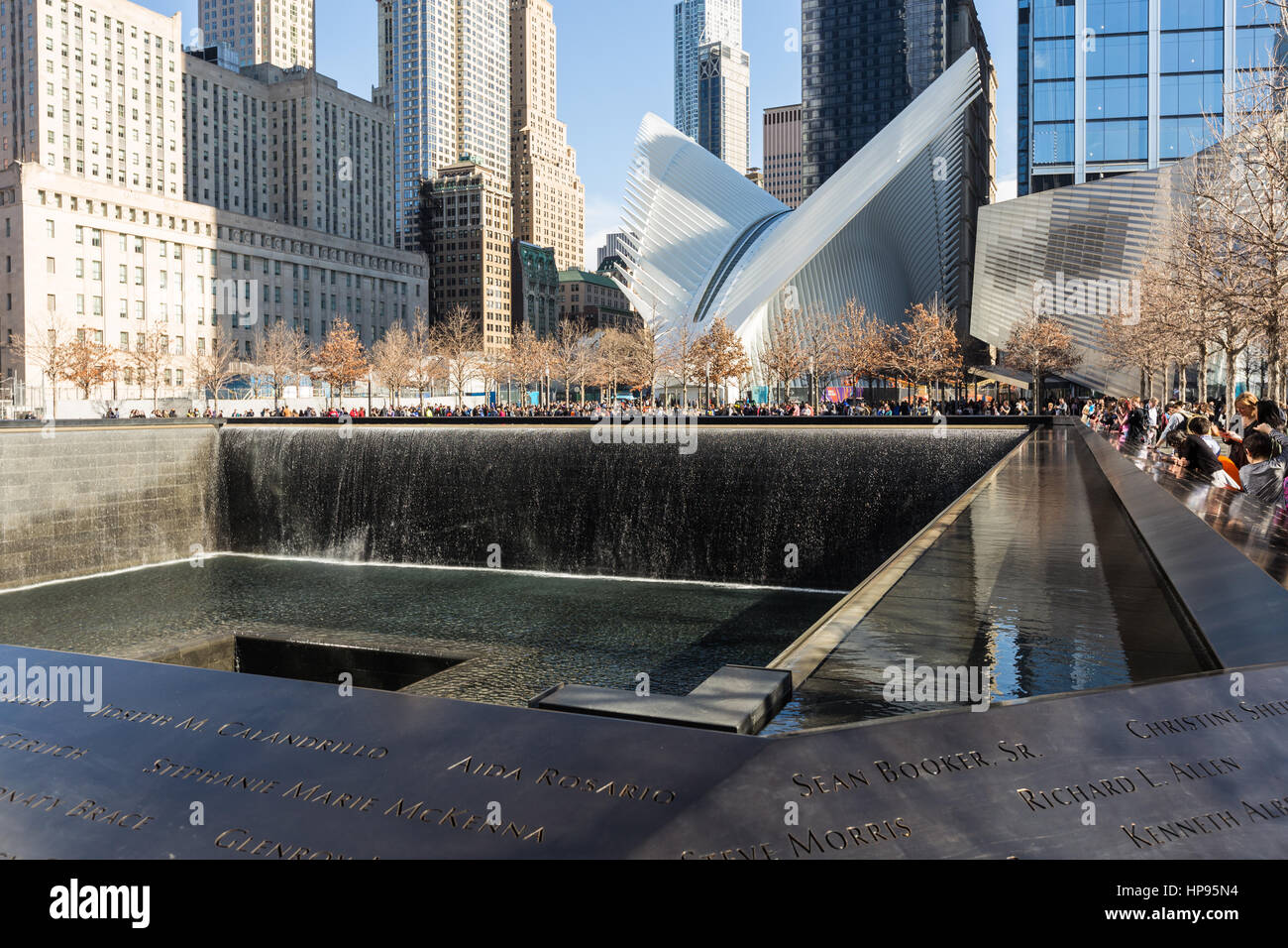 The North Pool of the National September 11 Memorial, with the Oculus World Trade Center Transportation Hub in the - Stock Image