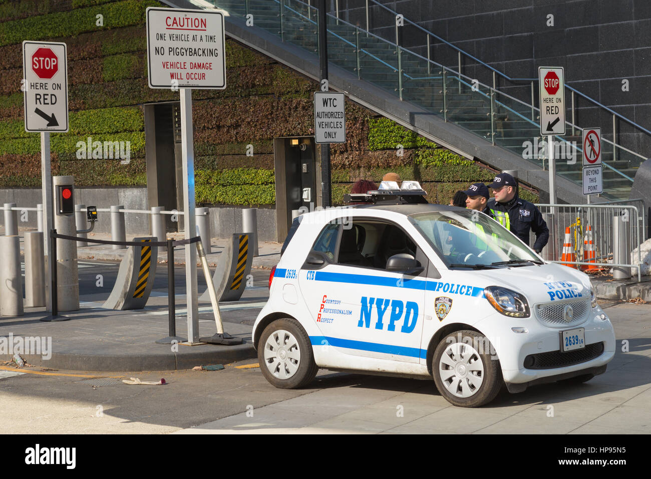 NYPD Counterterrorism Bureau officers, using a new Smart Fortwo smart car, provide security at the World Trade Center - Stock Image