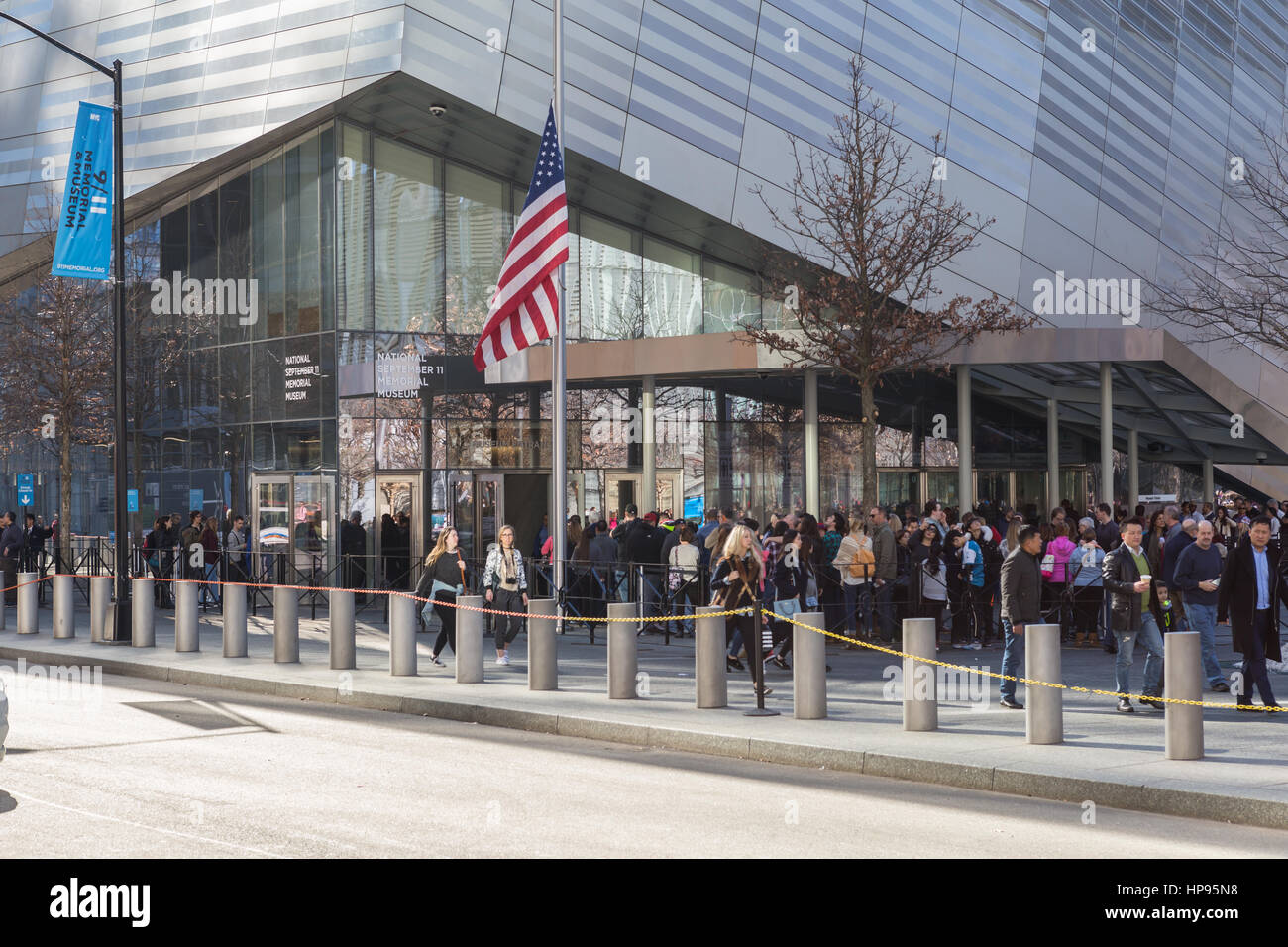 People wait in line to enter the National September 11 Memorial Museum in New York City. - Stock Image