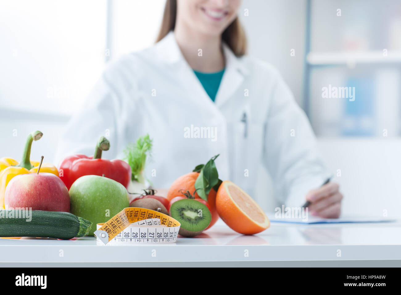 Sensational Nutritionist Desk With Healthy Fruit Vegetables And A Download Free Architecture Designs Scobabritishbridgeorg
