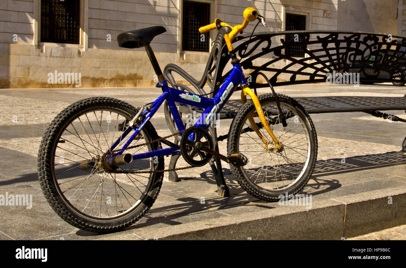 Isolated Bike against Bench - Stock Image