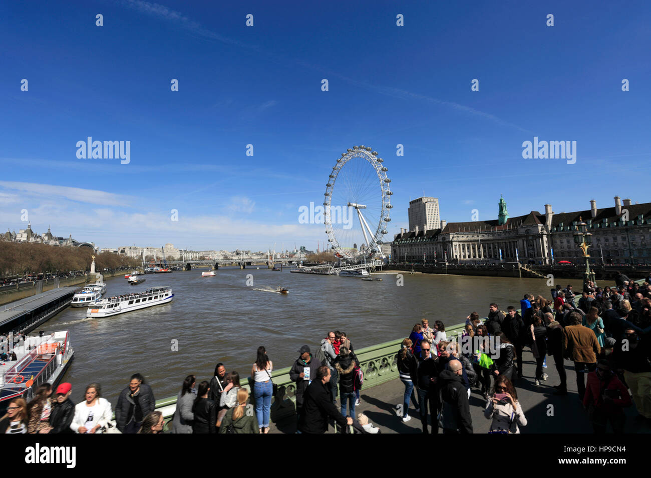 Tourists at the London Aquarium and Millennium Wheel, South Bank, River Thames, Westminster, London City, England, - Stock Image