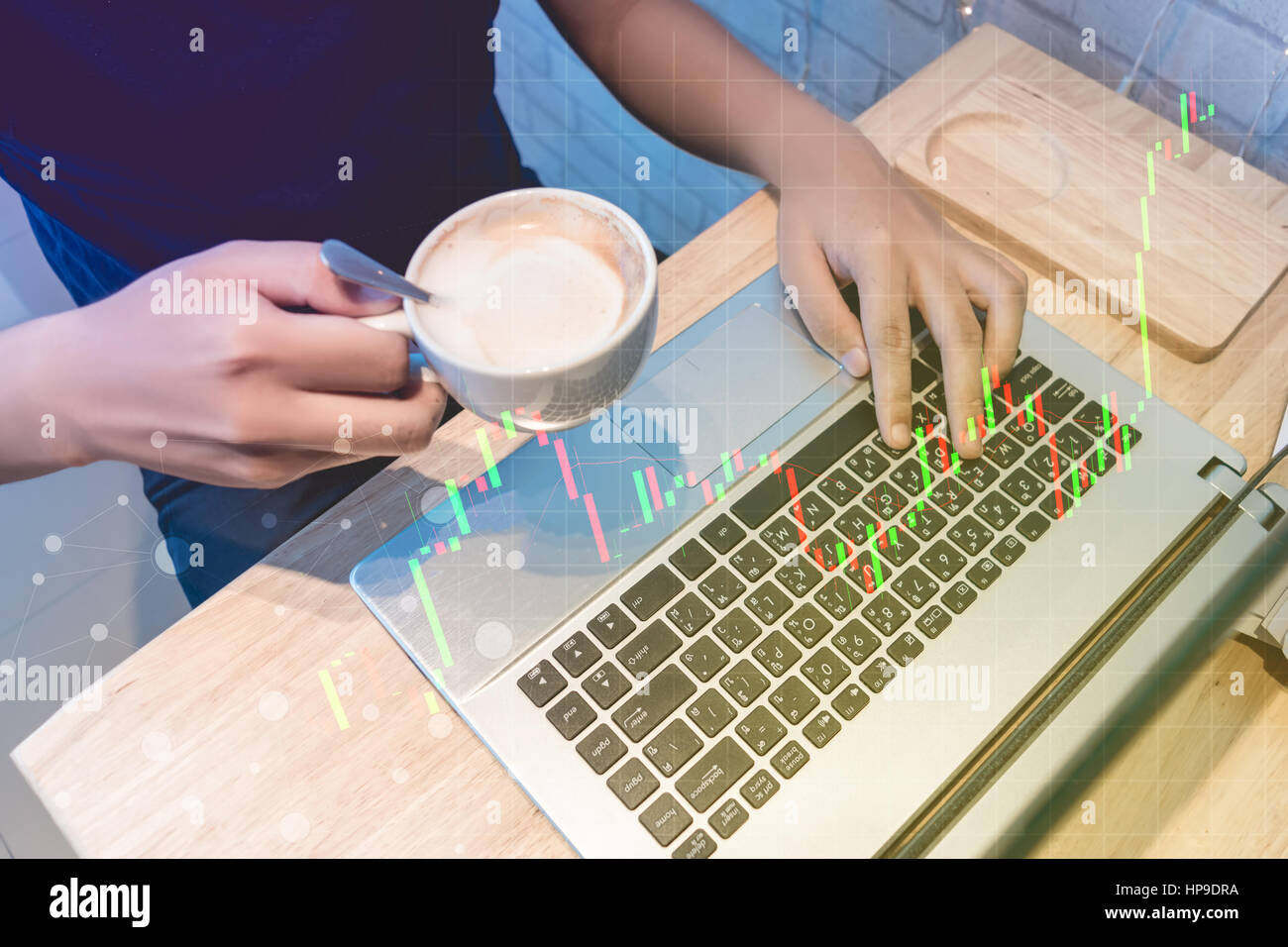 business trading concept : man trade stock and forex in notebook and analysis market financial data statistics chart - Stock Image