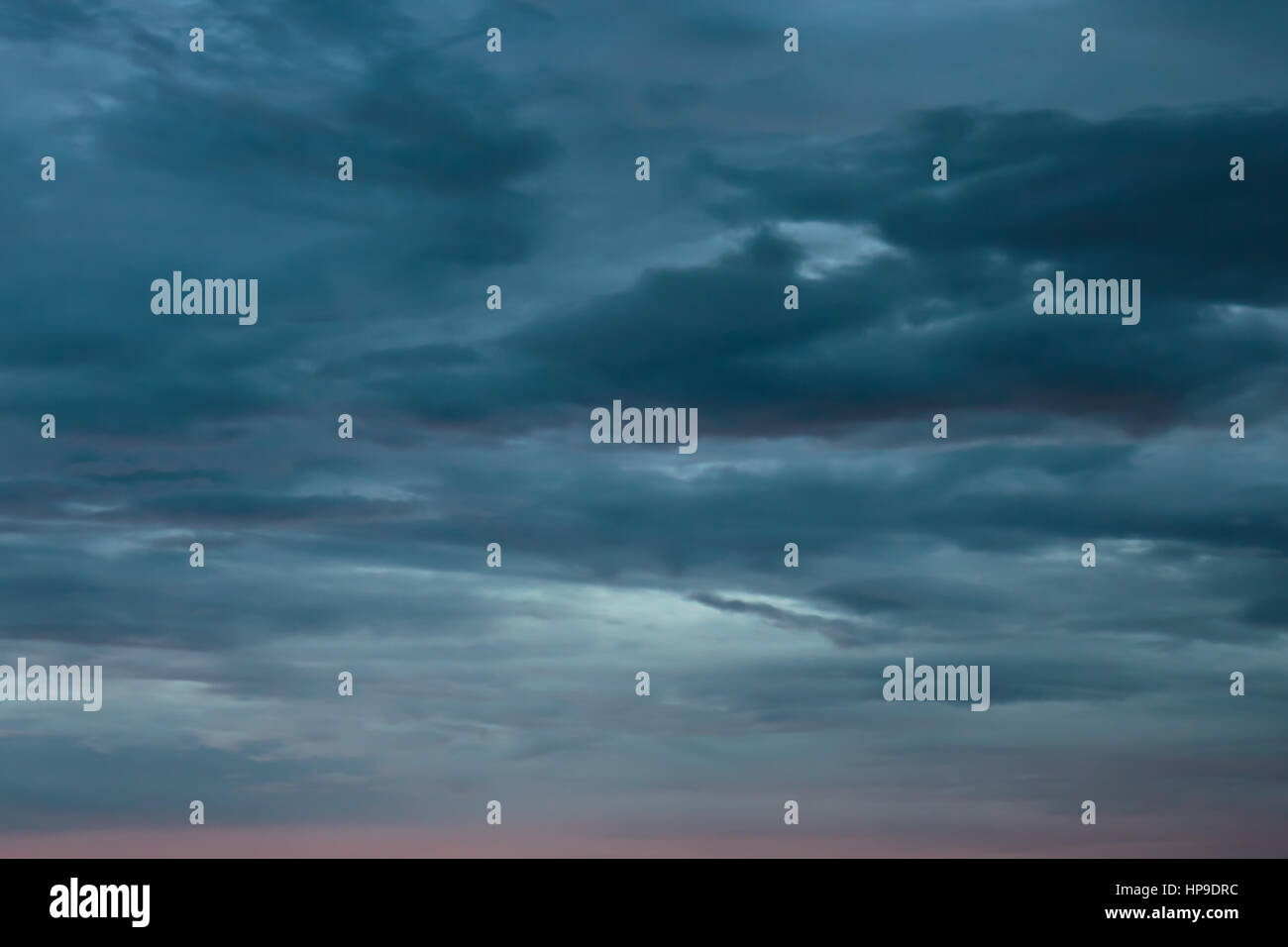 overcast gray and red evening sky for background Stock Photo
