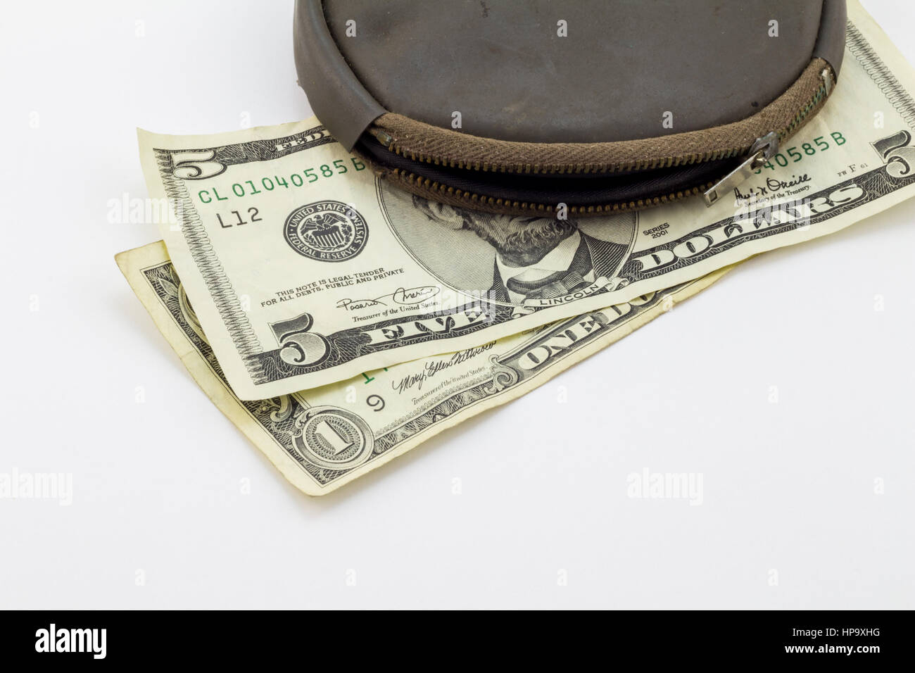 Worn empty wallet/purse with Five Dollar and One Dollar bills on white background - Conceptual image - poverty in - Stock Image