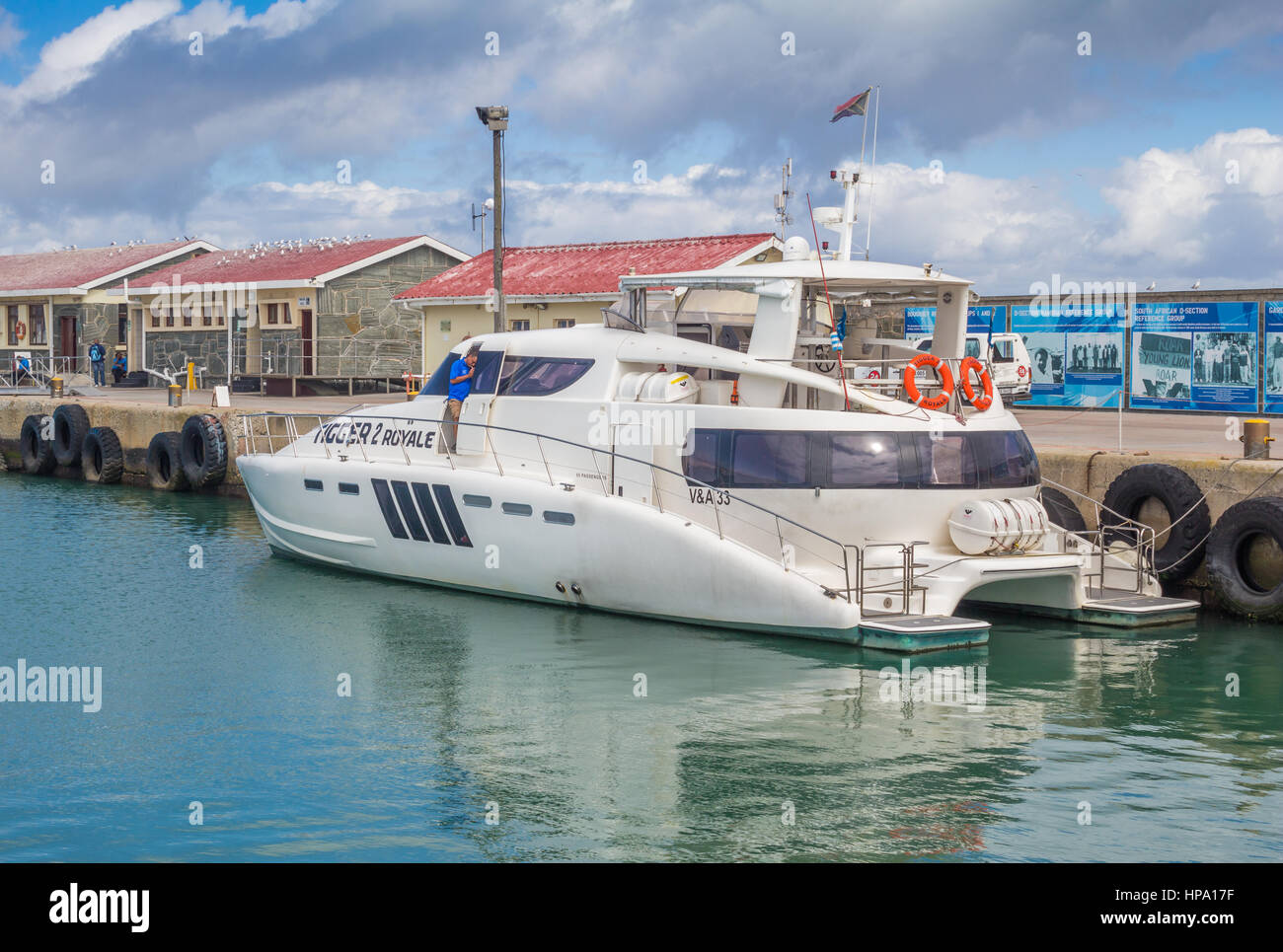 ROBBEN ISLAND, SOUTH AFRICA - DECEMBER 19, 2016: Photo of luxury 55 foot power cat berthed at dock at Robben Island - Stock Image
