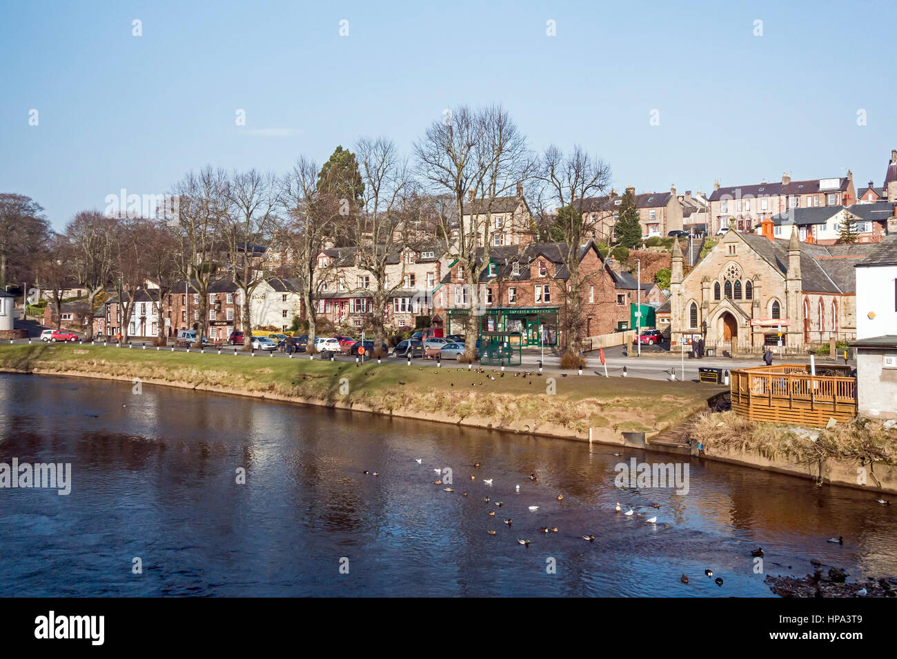 River Eden flowing through Appleby-in-Westmorland in Cumbria England on a sunny winter day - Stock Image