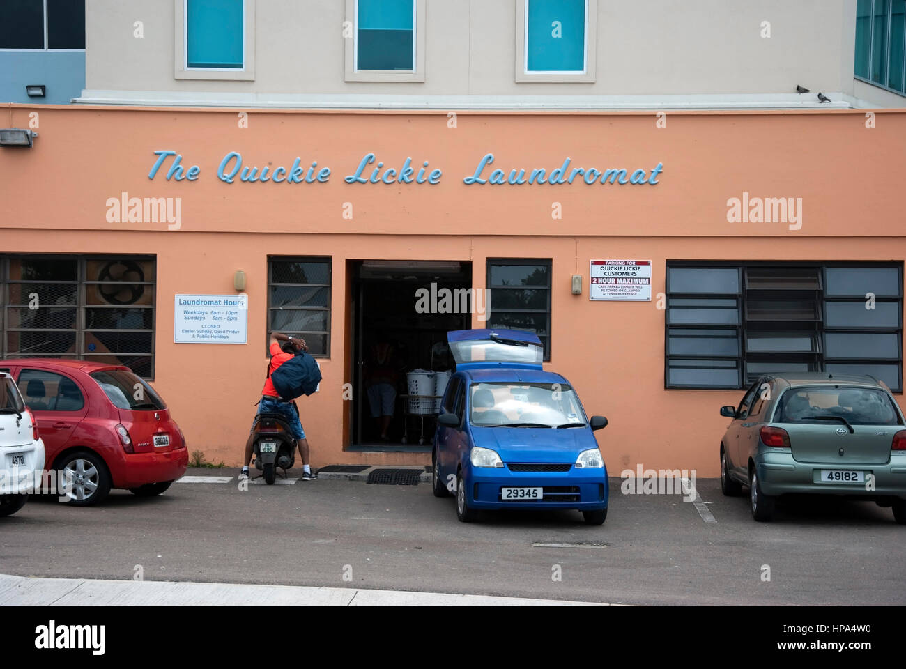 The Quickie Lickie Laundromat 74 Serpentine Road Hamilton Bermuda exterior view of peach colour color premises building - Stock Image