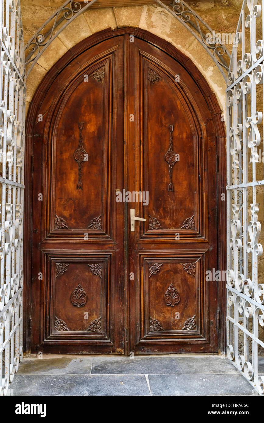 Ancient wooden door in Old city, Icheri Sheher at Baku, Azerbaijan. - Stock Image