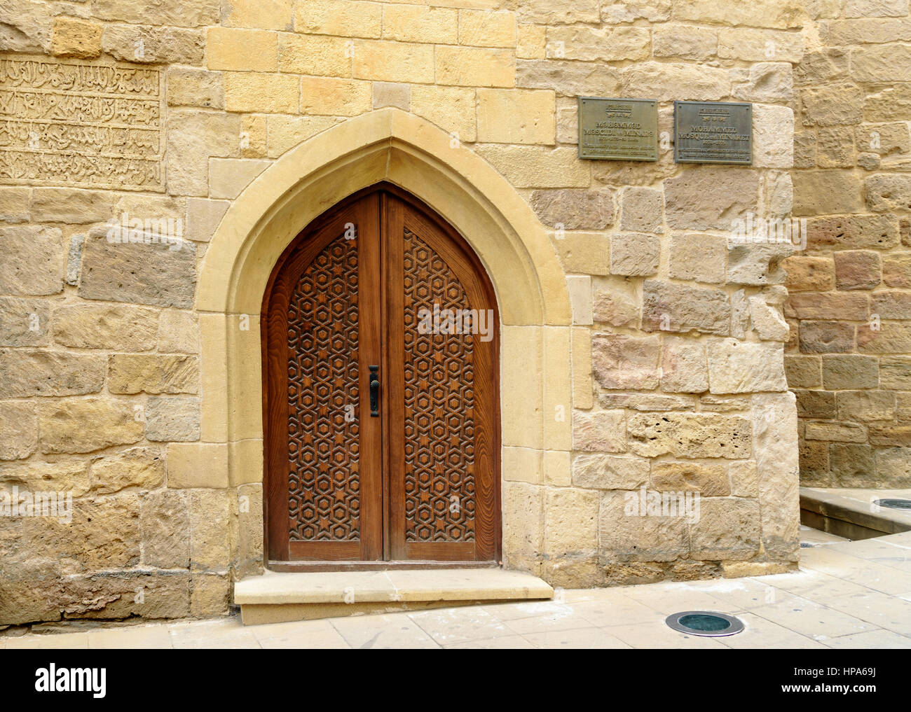 Baku, Azerbaijan - September 10, 2016: Traditional wooden door with curved arch in Old city, Icheri Sheher is the - Stock Image