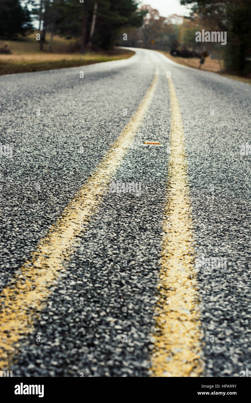Off-centered view of a gravel road. No passing. - Stock Image