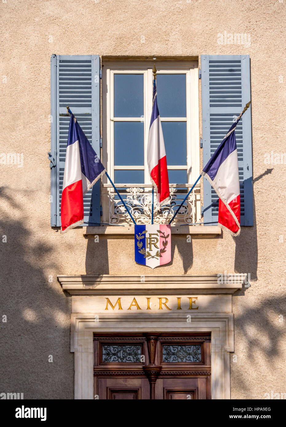 French flags at a city hall frontage - Stock Image