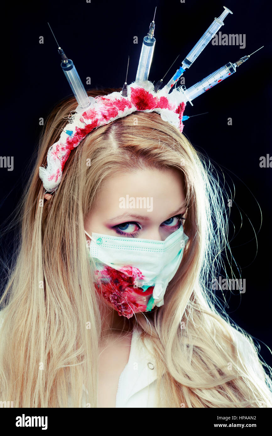 Halloween costume of a crazy nurse with crown made of syringes and a syringe in the hand & Halloween costume of a crazy nurse with crown made of syringes and a ...