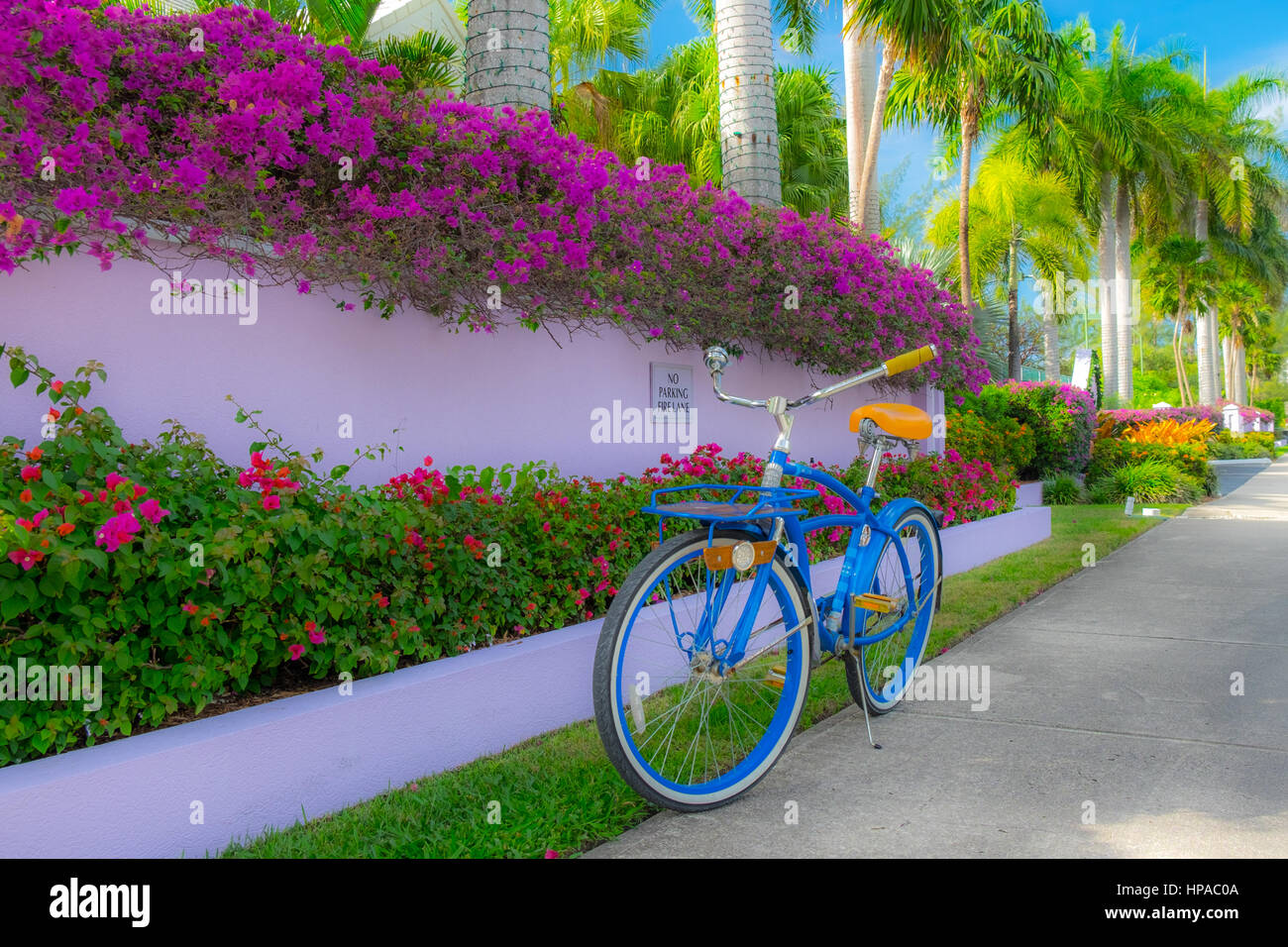 Photographer's Bike Park On A Pavement In Grand Cayman - Stock Image
