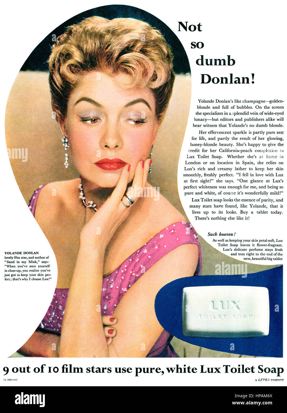 1956 British advertisement for Lux Soap, featuring actress Yolande Donlan. - Stock Image