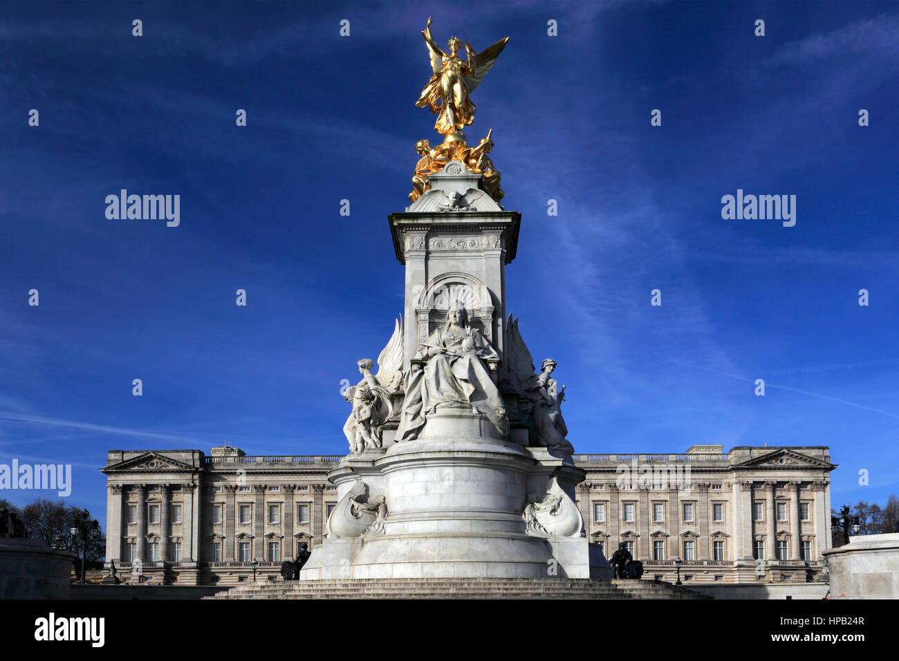 Summer view of the frontage of Buckingham Palace and Queen Victoria Monument, St James, London, England, UK - Stock Image