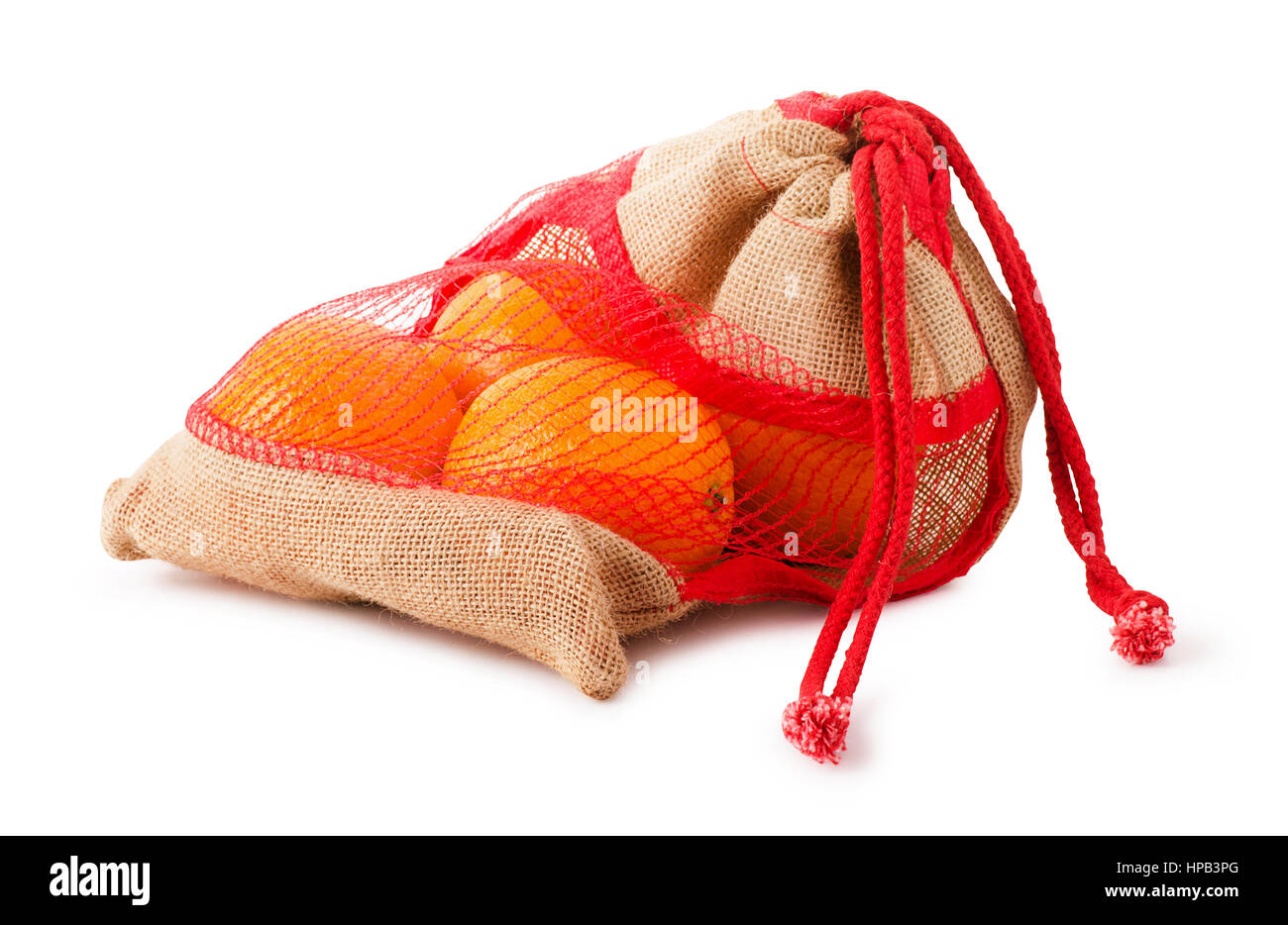 Fresh oranges in plastic canvas mesh sack isolated on white background - Stock Image