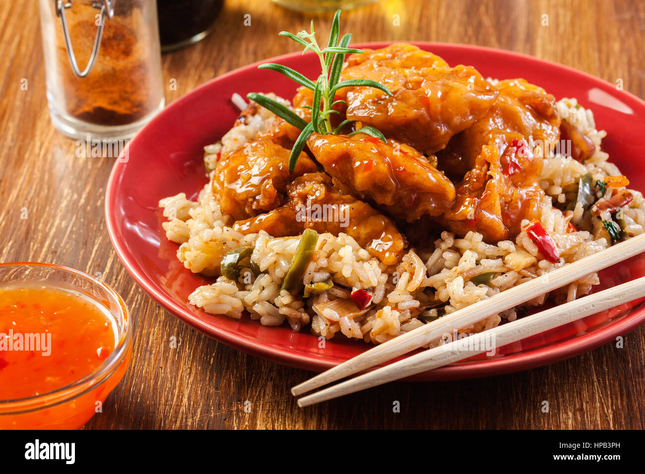 Fried chicken pieces with rice and sweet and sour sauce - Stock Image
