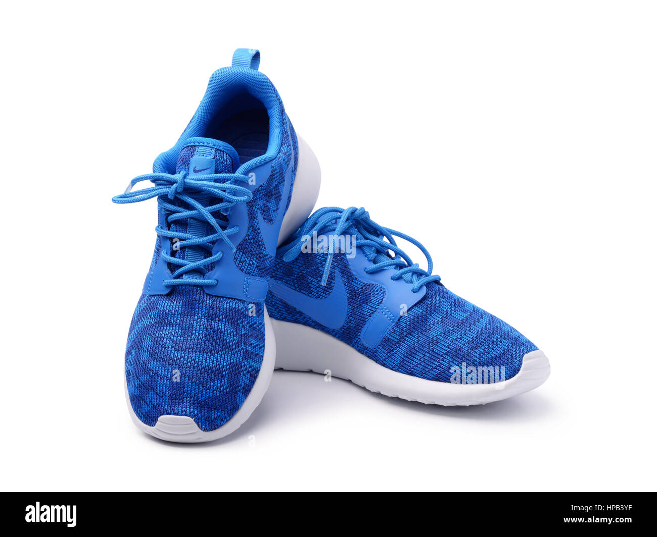 SAMARA, RUSSIA - June 8, 2015: female Nike sneakers for running, training, in gray and blue, showing the Nike logo, - Stock Image